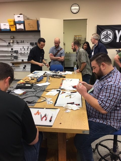 Technicians trying out some specialized Yamaha repair techniques.